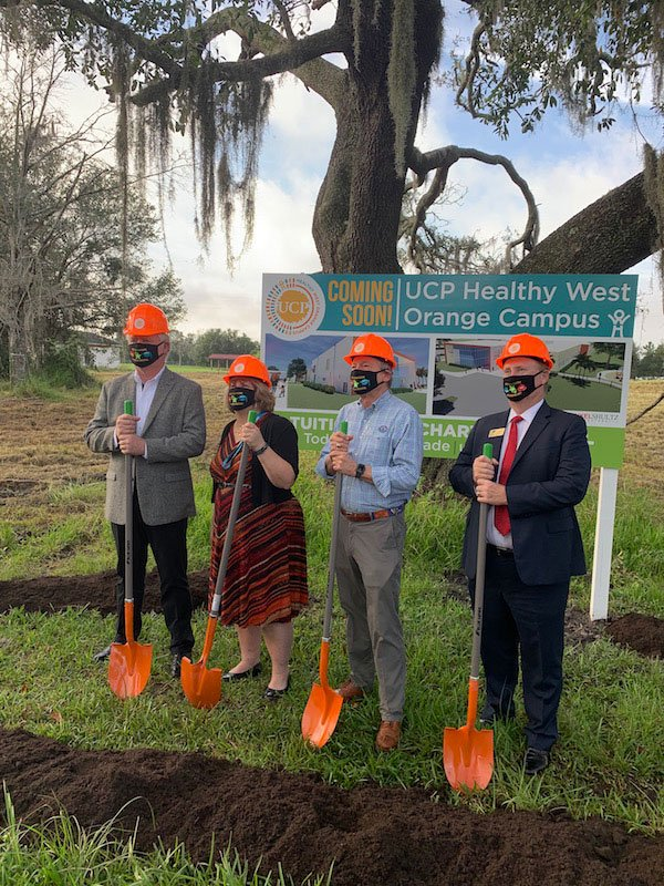UCP groundbreaking with orange shovels